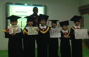 Reginald with graduates