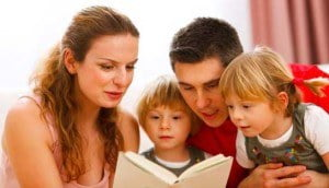 parents-reading-to-two-children1